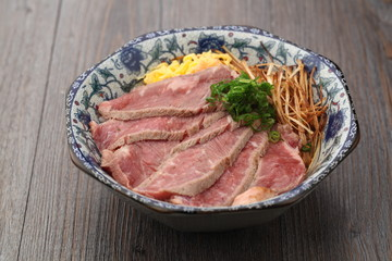 Sliced meats served in a bowl
