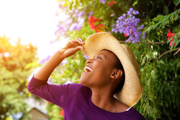 Excited young african woman with hat