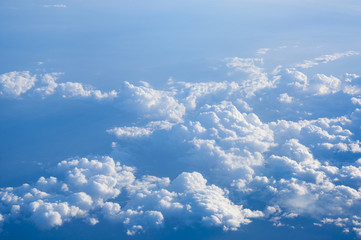 Wall Mural - Clouds in blue sky aerial view from plane