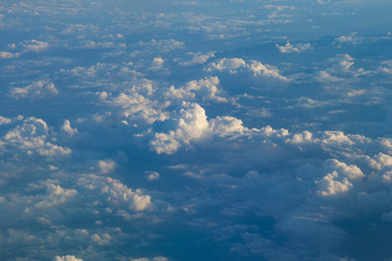 Wall Mural - Clouds in blue sky aerial view from airplane