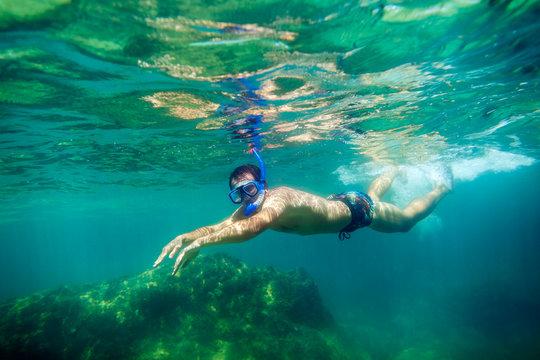 snorkling man swim underwater