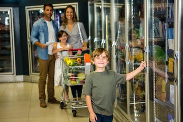 Cute family doing grocery shopping together