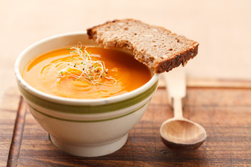 Pumpkin soup from carrots, 2 potatoes and Hokkaido pumpkin decorated with sprouts plus a slice of bread
