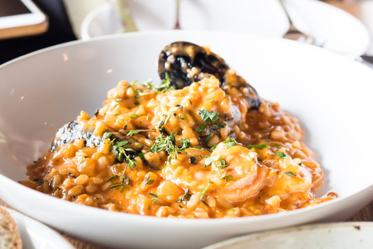 Seafood risotto on white plate