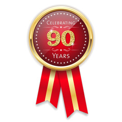 Red celebrating 90 years badge, rosette with gold border and ribbon