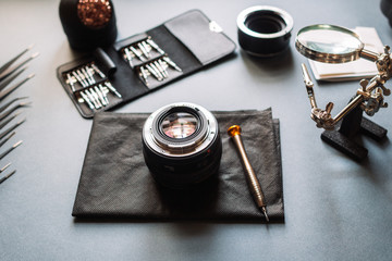 Photo camera lens repair. Maintenance support