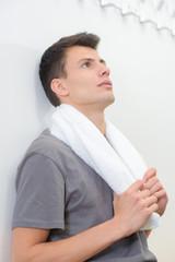 boy with towel in locker room