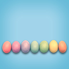 Pastel Easter eggs aligned, blue background