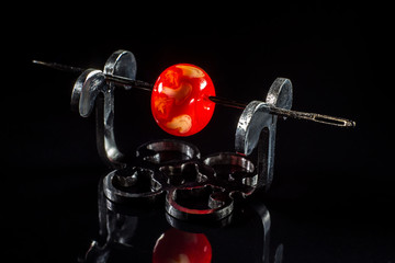 Red glass bead on stand