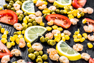 Colorful vegetable or mediterranean cuisine background with shrimps