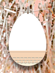 Close-up of one hanged Easter egg with peg against out of focus abstract art background