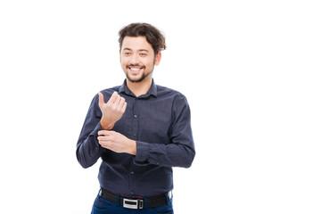 Smiling man buttoning shirt