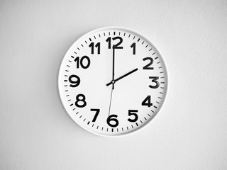 Monochrome clock on the wall for background