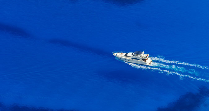 Aerial view of single yacht in azure sea