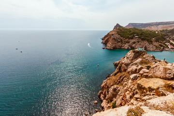 High stony coast at deep blue sea