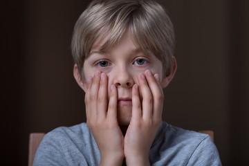 Little boy feeling afraid