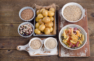 Healthy Food: Best Sources of Carbs on a wooden background.