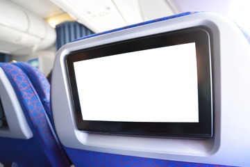 White LCD screen in an airplane seat.