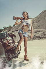 Sexy biker woman with the rifle