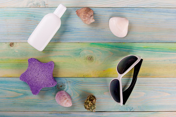 Summer sea vacation mockup background. Notebook blank page with Travel items on blue green wooden table. Sea shells, pebbles, top view.