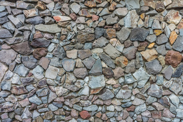Natural dry stone wall for exterior decoration. The  structures are constructed from stones or rocks  without any mortar and plaster  to bind them together.