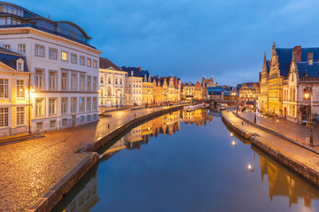 Picturesque medieval buildings on quay Korenlei and  quay Graslei,  Leie river in the evening, blue hour, Ghent, Belgium