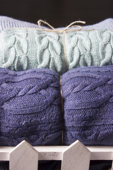 Warm knitted blankets folded stack. Comfort and convenience