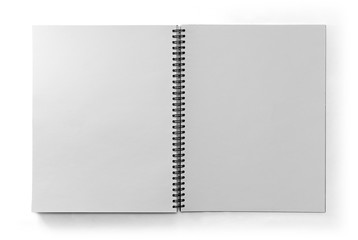 Paper notebook with black metal spring isolated on white background in top view with clipping path.