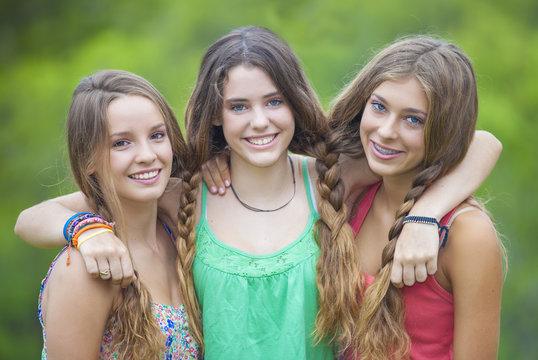happy smiling teenage girls with white teeth