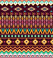 Seamless stylized stripes pattern with aztec ethnic and tribal ornament. Vector bright colors boho fashion illustration.