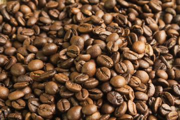 coffee beans roasted Brown background