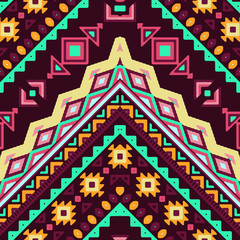 Seamless hand drawn chevron pattern with aztec ethnic and tribal ornament. Vector dark and bright colors boho fashion illustration.