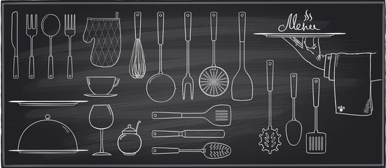 Set of kitchen utensils and tableware on a chalkboard