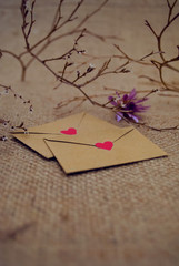 Romantic envelope with heart and love letter on fabric background. The best present for valentines day.