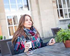 Young girl enjoying coffee with her music