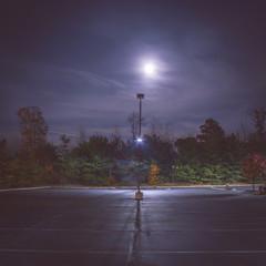 Parking lot at night under the moonlight