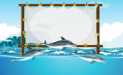 Border design with three dolphins swimming