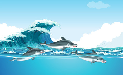 Dolphins swimming under the ocean