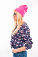 Side view photo of girl in glasses and pink cap