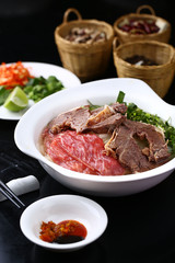 Raw and cooked beef pho soup