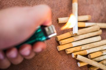 Quitting smoking : hand burn cigarette
