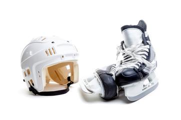 Ice Hockey Helmet and Skates Isolated on White