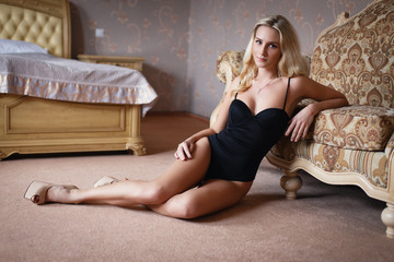 Beautiful  blonde girl in a sexy  lingerie