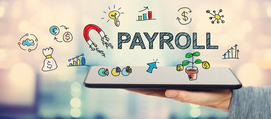 Payroll concept with man holding tablet
