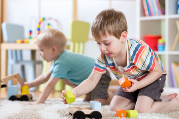 Children playing with toys in kindergarten or daycare or home