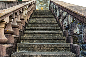Old, stone stairs on side of building