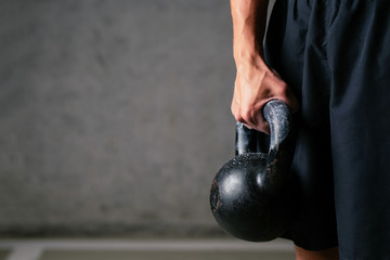 Closeup of athlete holding kettlebell weight