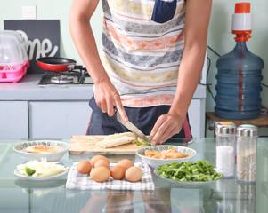 Man preparing ingredients for a healthy meal