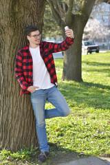 Handsome guy is taking a selfie outdoor