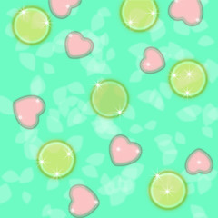 candy in the shape of hearts and circles on a turquoise background with bokeh